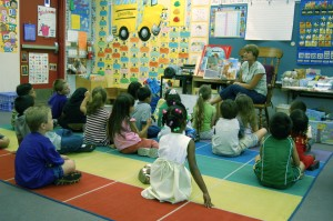 Children sitting on floor at story time