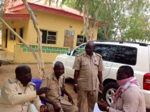 Emmanuel Mbaezue interviewing some immigration security personnel I met at the border between Nigeria and Niger Republic. Posted with permission from Emmanuel Mbaezue.